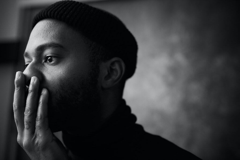 Beautiful, powerful and artistic black man thinking.