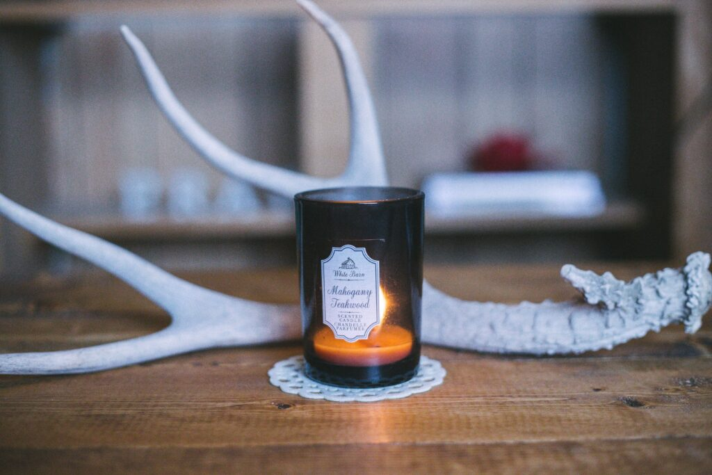 scented candle near deer horn