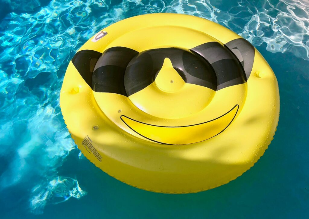 yellow and black emoji inflatable floater