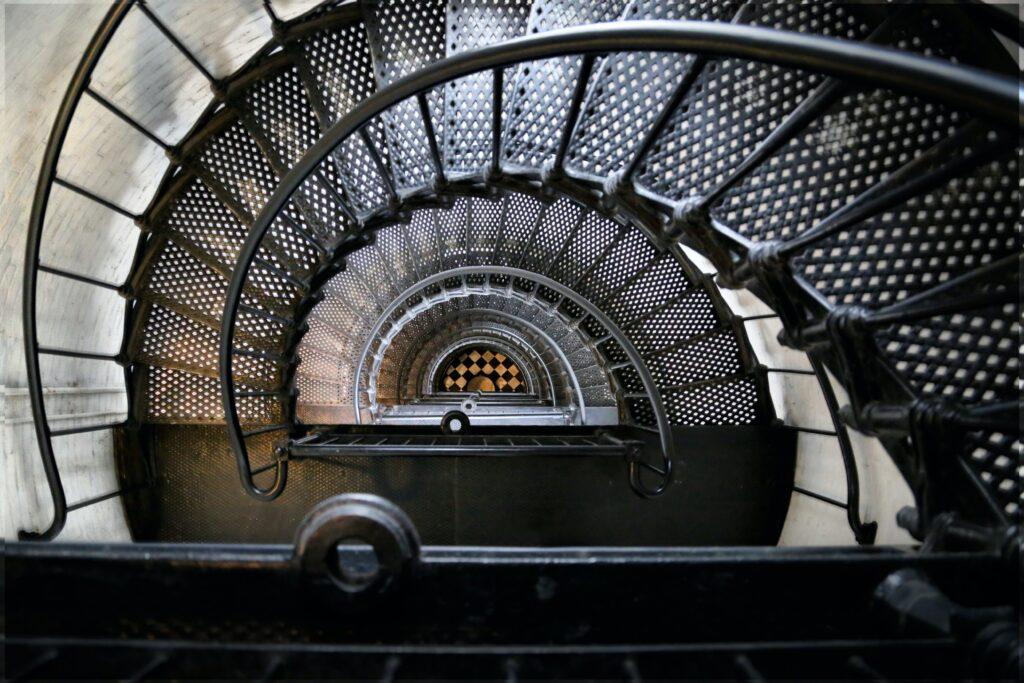 black spiral staircase with black metal railings