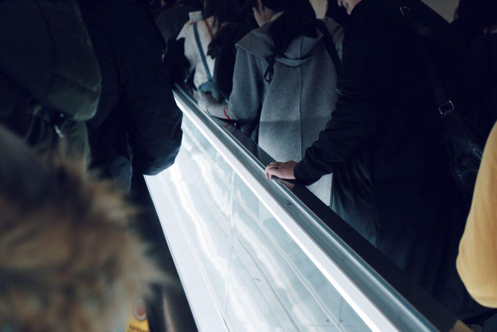 people on elevator inside building