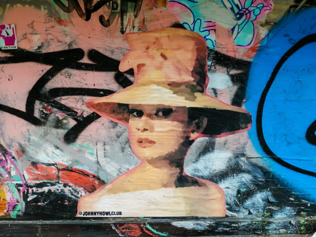 woman in brown hat painting