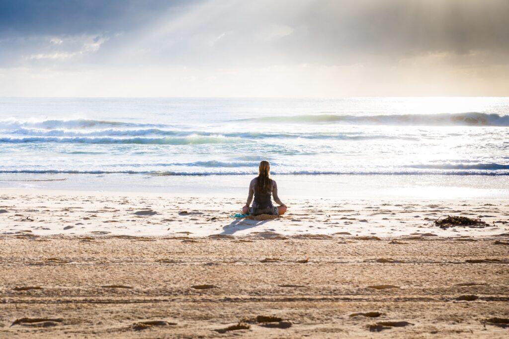 woman sitting on seashore