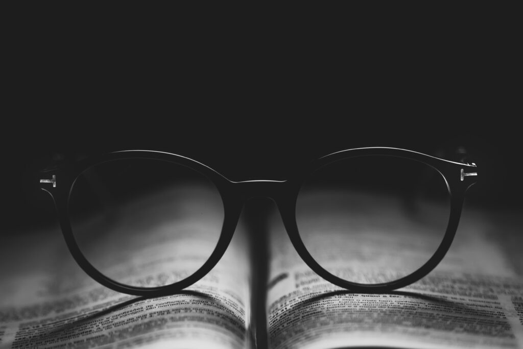 photo of eyeglasses on book page